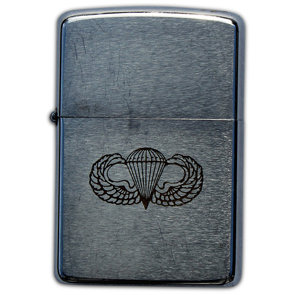 Eugene Grapa's engraved Zippo lighter. (5)