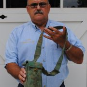 Robert Cook holds his captured NVA pouch, July 2011. 1A