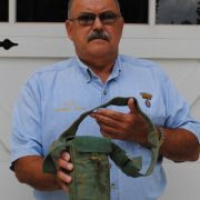 Robert Cook holds his captured NVA pouch, July 2011. 2A