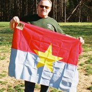 Thomas Groll holding hiis captured VC flag, March 2008.