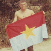 Tom Groll with captured VC Flag Chu Lai Aug 67 (Groll)
