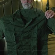Richard Mullowney holding his CISO indigenous uniform top, October 2018.2B