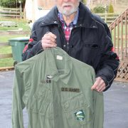 Dennis Casey holding his LLDB badged uniform, 01-31-20. 1A